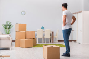 man frustrated by moving alone